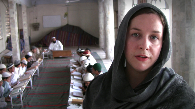 The author reporting from an Islamic religious school in Pakistan in 2009 (Photo: Alex Stonehill)