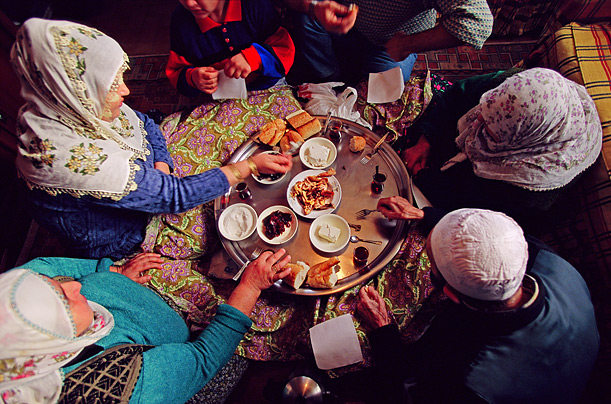 A photo by Peter Menzel from the Hungry Planet book shows a Turkish family eating breakfast