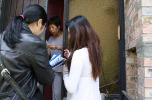 Linh Vu and Nancy Huang ask a Beacon Hill resident if she's registered to vote. (Photo by Kat Chow)