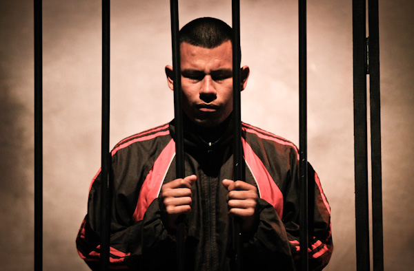 An inmate performs during a play at a public theatre in Lima