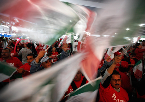 Supporters of Pena Nieto celebrate at party headquarters in Mexico City