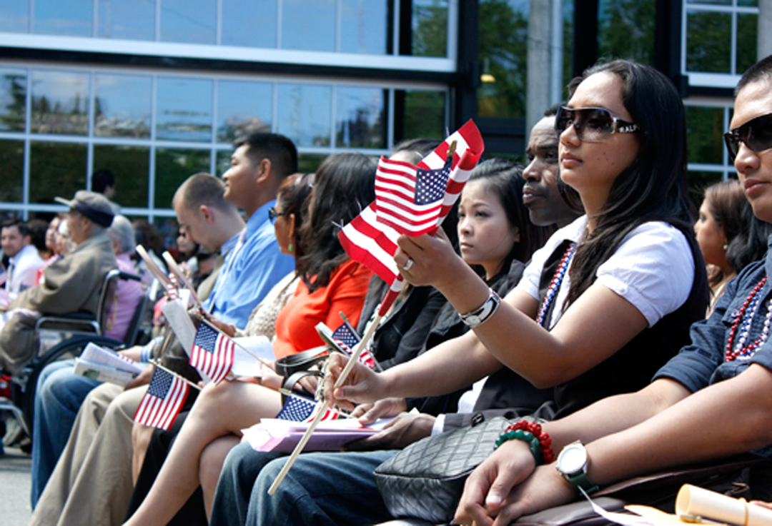 Candidates for U.S. citizenship wait to be sworn in at the 28th Annual Naturalization Ceremony on July 4th at the Seattle Center.