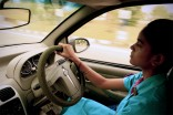 Chandni Gautam is one of the few women drivers on the road as she navigates her cab through the streets of New Delhi, India. Gautam is one a select few female cab drivers at Sakha, a company for and by women offering safe, 24-hour transportation. (Photo by Bhamati Sivapalan)