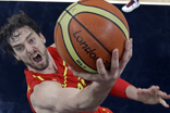 Spain's Gasol drives past Love of the U.S. to score during the men's gold medal basketball game at the 2012 Summer Olympics in London