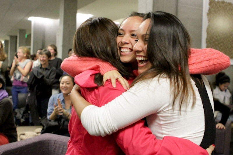 Garcia (left) celebrates with fellow UW students Jessica Oscoy and Tania Santiago as Obama's reelection is announced at a UW watch party. (Photo by Joshua Bessex/The University of Washington Daily)