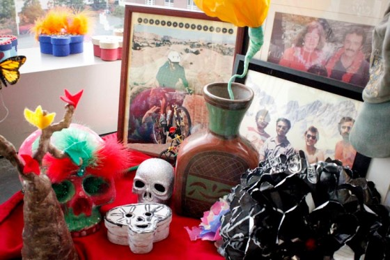 An altar created by the Enrique family honoring a family member. The photographs show important moments he spent with his family. The skulls and the leaves of the tree make people remember how his personality is still alive. (Photo by Liliana Caracoza)