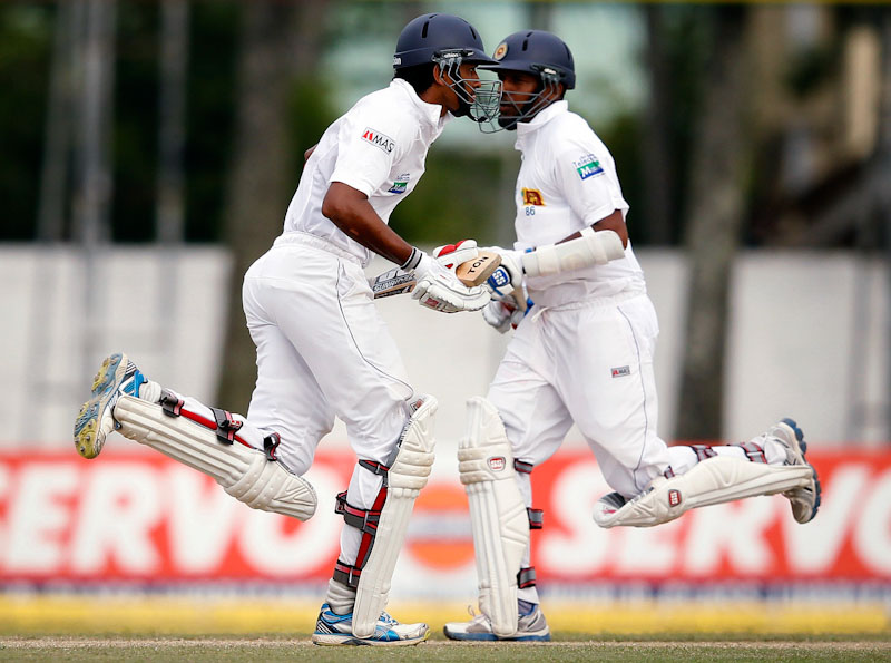 Despite appearances, Cricket doesn't involve synchronized dance routines. It does have players running back and forth between two different wickets, rather than four bases, as in baseball. (Photo from REUTERS/Dinuka Liyanawatte)