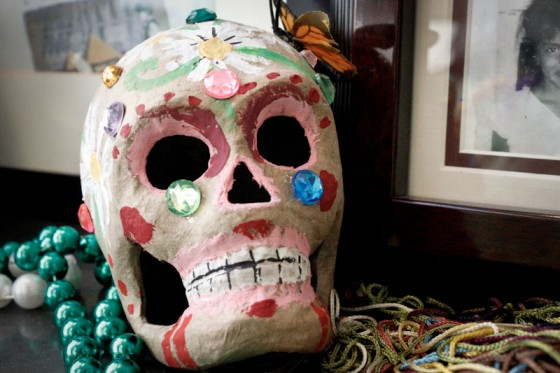 "Skull candies and ""La Catrina"" are the two most well-known symbols of the celebration. The butterflies and the bright colors placed on the skull make it more attractive and symbolic. It shows that the skull represents not just death but it also reflects a living and happy tone. (Photo by Liliana Caracoza)"