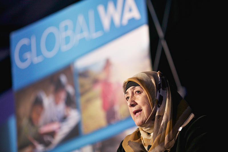 "Dr. Sakena Yacoobi, founder of the Afghan Institute of Learning, addresses a Global Washington conference last week. GlobalWA hopes to bring NGOs out of their ""silos"" and collaborate with our organizations. (Photo courtesy of GlobalWA)"