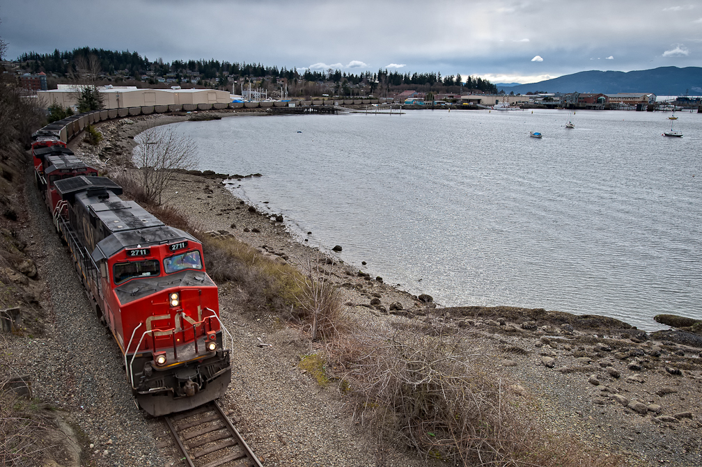 A train carrying coal hugs the Puget Sound on it's way to the Westshore coal terminal in BC. With a proposed new coal terminal in Bellingham, train shipments through Washington State are set to increase dramatically. (Photo by Paul K. Anderson)