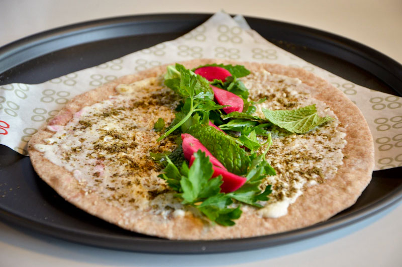 Manou'she jibneh wi zaatar aka pita with cheese, spices and mint. (Photo courtesy Mamnoon)