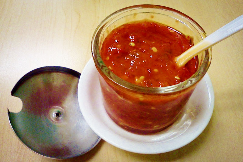 The much-adored Green Village homemade pepper sauce. Made fresh in house, it's a favorite among the restaurant's regular guests. (Photo by Lisa Strube-Kilgore)