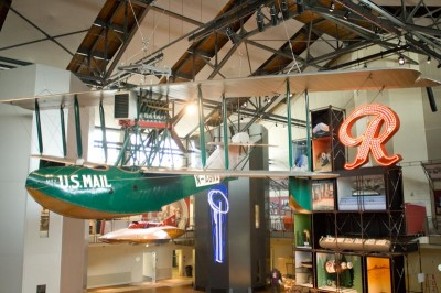 The Boeing plane that made the world's first international air mail run hangs in the MOHAI atrium. (Photo by Garrett Mukai)