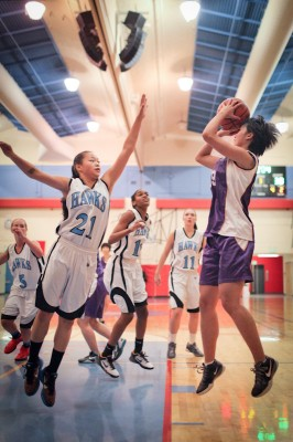 Nankai forward Yang Xue shoots over Chief Sealth guard Samantha Scroggins. Nankai, which is the 8th ranked high school girls team in China, won the game 57-40. (Photo by Alex Stonehill)
