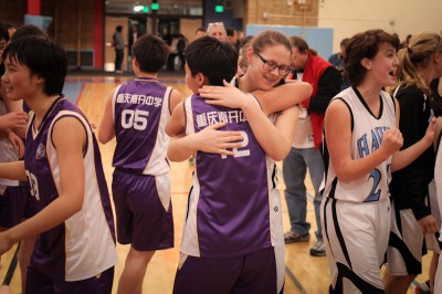 Chief Sealth Sophmore Jessie Dirks and Nankai Sophmore Zhao Yi embrace after the game. (Photo by Alex Stonehill)