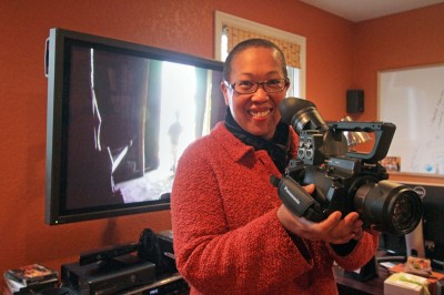 Filmmaker Eli Kimaro in her Columbia City home. Her documentary 'A Lot Like You' has won acclaim around the world and opens at the Seattle Asian American Film Festival tonight. (Photo by Greg Gilbert/Seattle Times)