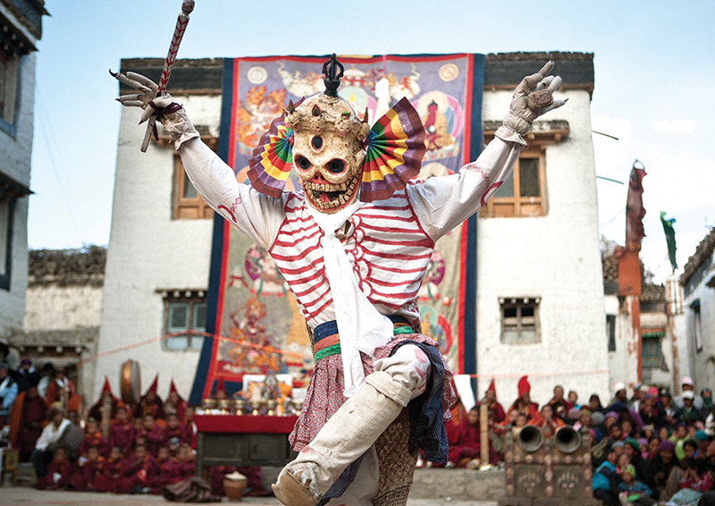 A costumed monk performs a dance at the Tiji festival in the town square of Lo Manthang. Many in the kingdom fear ancient traditions will be lost as modernization takes hold. (Photo by Taylor Weidman)