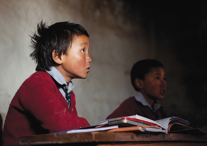 Students learn the national curriculum in the mother language at an NGO-supported private school in Lo Manthang. The community hopes to preserve their unique Tibetan dialect, Lowa, for future generations. (Photo by Taylor Weidman)