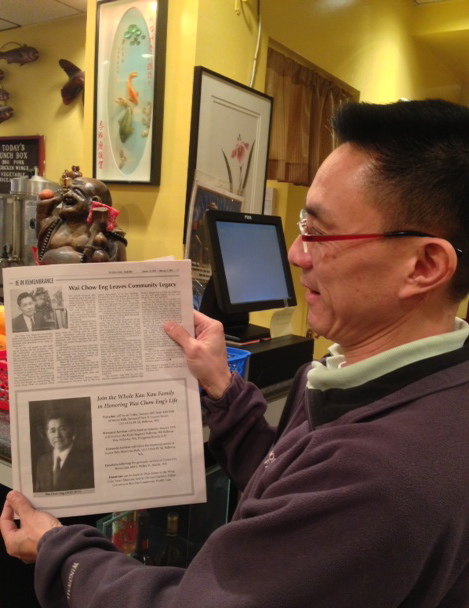 Richard Chang points out Eng's picture in the newspaper (upper left). Photo by Jessica Kamzan
