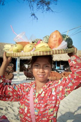 Selling fruit on the beach in Sihanoukville. (Photo by Roxana Norouzi)