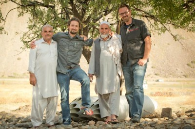 Combat Flip Flops founders Matthew 'Griff' Griffin (second from left) and Andrew Sewrey (right) pose with locals in the Panjshir Valley, Afghanistan. (Photo by Jed Conklin)