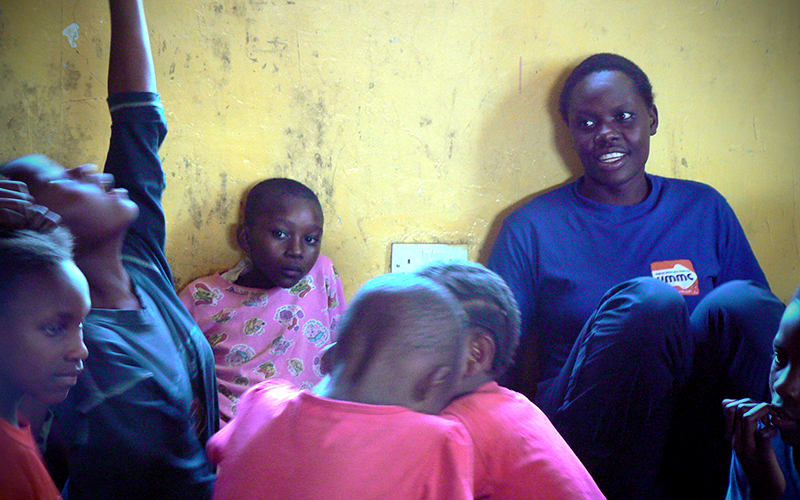 Emily teaches poetry to young women in Kibera, Kenya. (Photo by Abby Higgins)