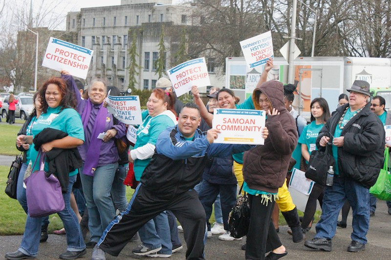 "OneAmerica organizers and participants march through the capitol campus in Olympia chanting, ""Who's house? Our house!"" (Photo by Brooklyn Carlson)"