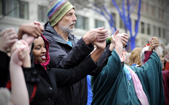 The crowd joins hands for the Dance of Universal Peace. (Photo by Colleen McDevitt)