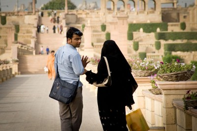 A conservative Pakistani couple out for a walk in the park in Karachi. (Photo by Alex Stonehill)