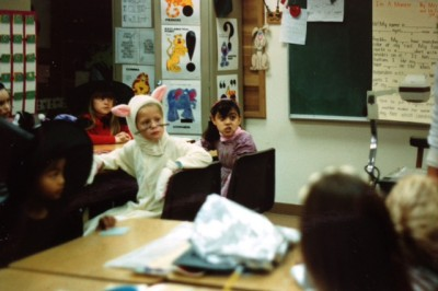 Chaunty Thook (far left) and Roxana (center) at a Halloween celebration in their 3rd grade classroom at Helen Keller elementary.