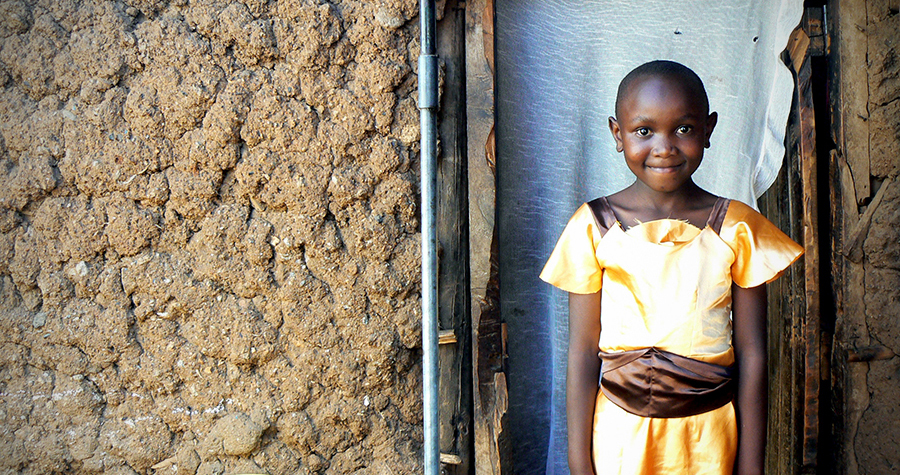 Jacktone Otieno's daughter Benta poses outside her home in Kibera, Kenya. Jacktone brags that Benta is at the top of her elementary school class. (Photo by Abby Higgins)