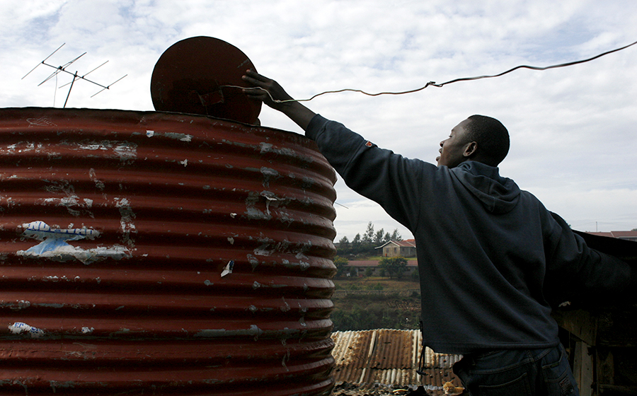 Disconnected from Nairobi's city utilities, Kibera residents built everything themselves from powerlines to water cisterns. (Photo by Alex Stonehill)