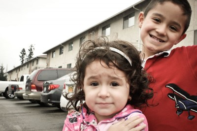 The author's niece and nephew, outside the Tacoma apartment building where they were interrogated. (Photo by Liliana Caracoza)