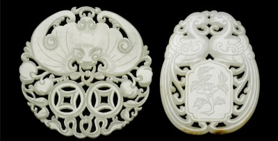 A pair of reticulated jade pendants from the 19th century that sold at 20 times their pre-sale estimate. (Photo from Bonham's auction catalogue)