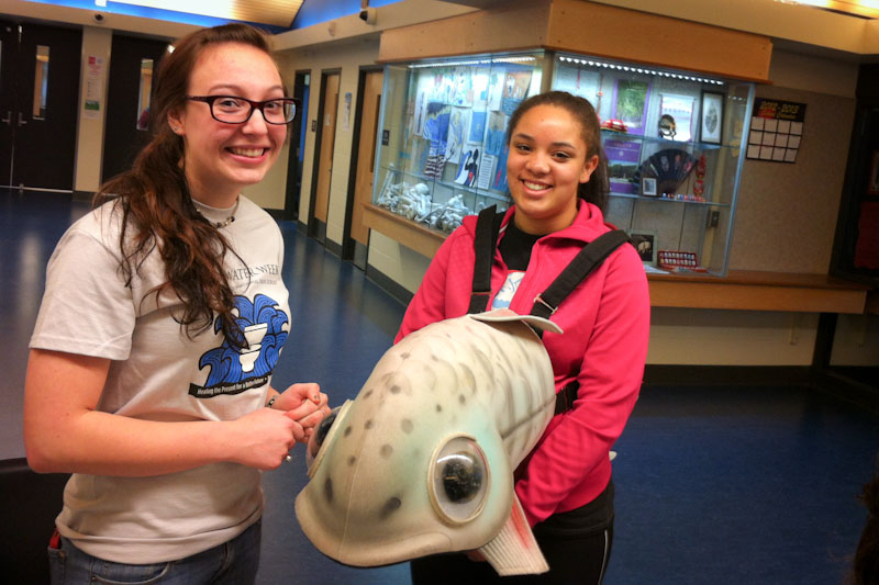 Chief Sealth students Sonora Carroll and Rachel Varney celebrate World Water Week. (Photo by Sarah Stuteville)