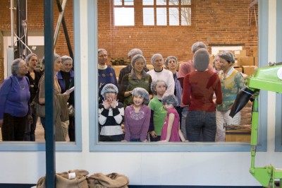 Kids press their face against the glass during a tour at Theo Chocolate in Fremont. (Photo by Sandi Heinrich)