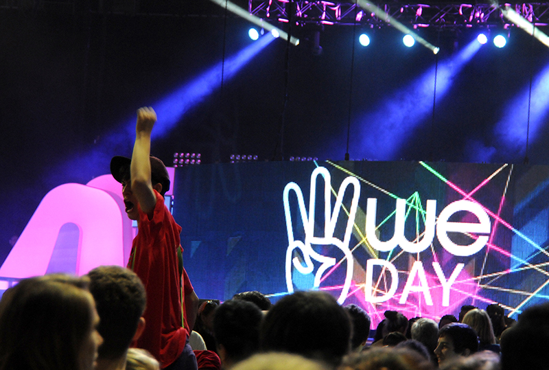 A youth pumps up the crowd at WeDay, a star-studded event to celebrate a year of community service. (Photo by Sara Stogner)