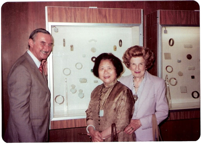 During the second exhibition of the Young family's robes and jades in 1981, Mary Young (center) poses next to these treasures with Jon Kowalek, former Tacoma Art Museum director, and Pearlie Baskin. (Photo courtesy of the Young family)