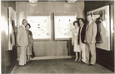 Al Young (second from right) and his parents (far left) during the second exhibition of the Young family's robes and jades in 1981. (Photo courtesy of the Young family)
