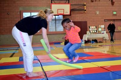 On day two of the festival,  children learned self defense tricks from Evergreen Karate Jujitsu. (Photo by Valeria Koulikova)