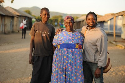 The author (right) with his aunt Penina (center) and another relative during a visit back to Kenya. (Photo by Jason Koenig)