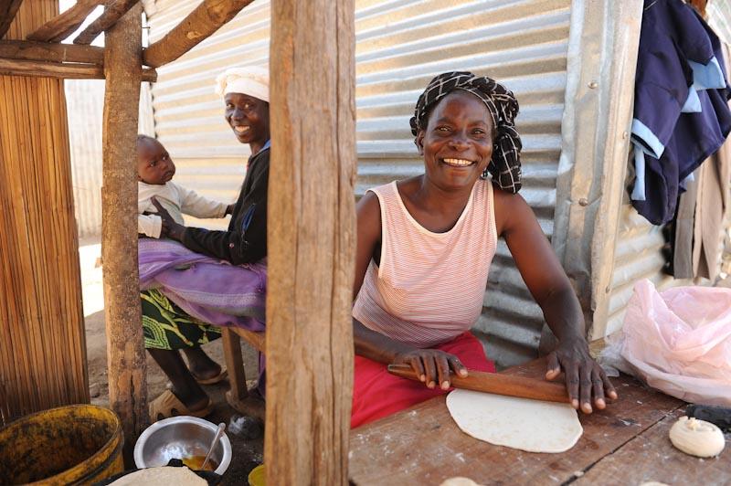 A merchant prepares chapati in the Manyatta slum in western Kenya. (Photo by Jason Koenig  )