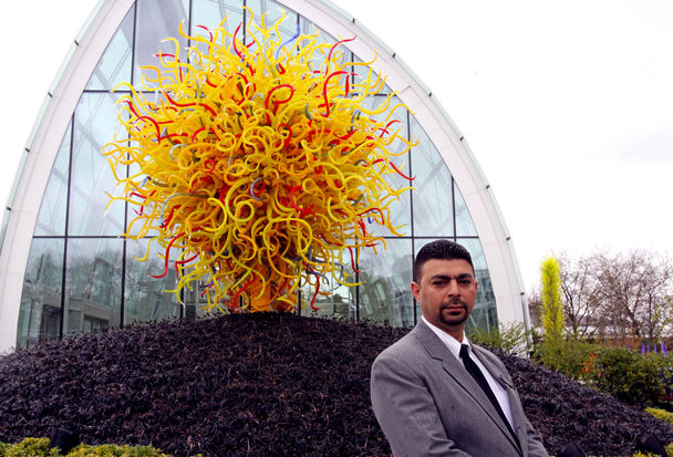 Muthanna Al-Nidawi, who recently emigrated from Iraq and is now a security guard at Chihuly Garden and Glass at Seattle Center. (Photo by Alan Berner/The Seattle Times)
