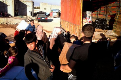 Aid from Seattle-based Salaam Cultural Museum arrives at a Syrian refugee camp in Jordan. (Photo from  Salaam Cultural Museum)