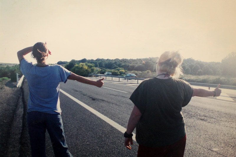 Sarah Stuteville (left) hitchhiking with friends in Spain in 2000. (Photo by Eroyn Franklin).