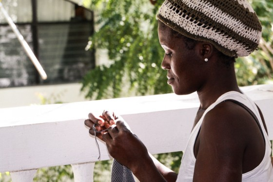 Beatrice, one of the mothers working with Haiti Babi, crochets a blanket. (Photo courtesy Katlin Jackson)