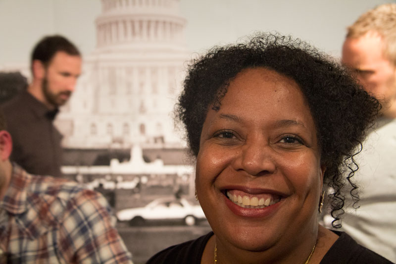 Sabrina Urquhart, Manager at Students Rebuild, smiles widely at the One in a Million reception on April 4. (Photo by Christian Zerbel)