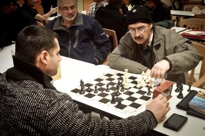 """Crossroads Mall prides itself as the """"living room"""" of the Eastside's immigrant community. Chess games are always in session. (Photo by Ilona Idlis)"""