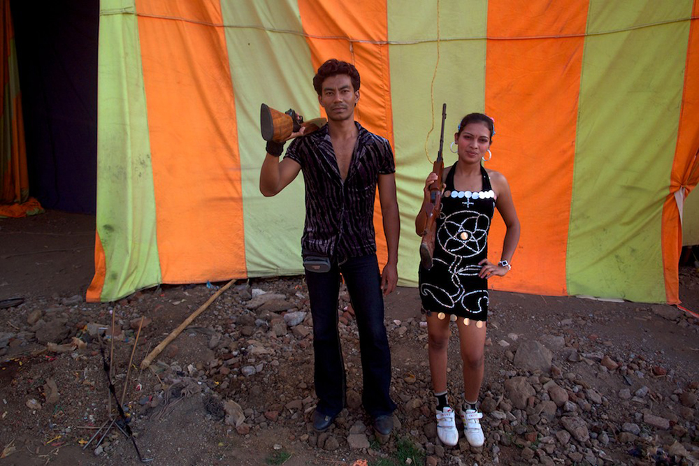 Circus shooting performers pose for the camera.