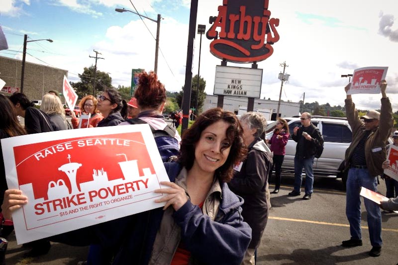 Elena Perez of the UFCW 21 Making Change at Walmart campaign joins the fast food workers picket at the Georgetown Arby's. (Photo by Reagan Jackson)